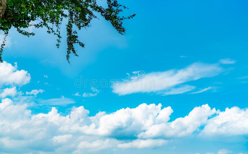 Beautiful blue sky and white cumulus clouds abstract background. Cloudscape background. Blue sky and white clouds on sunny day. Nature weather. Bright day sky royalty free stock photo