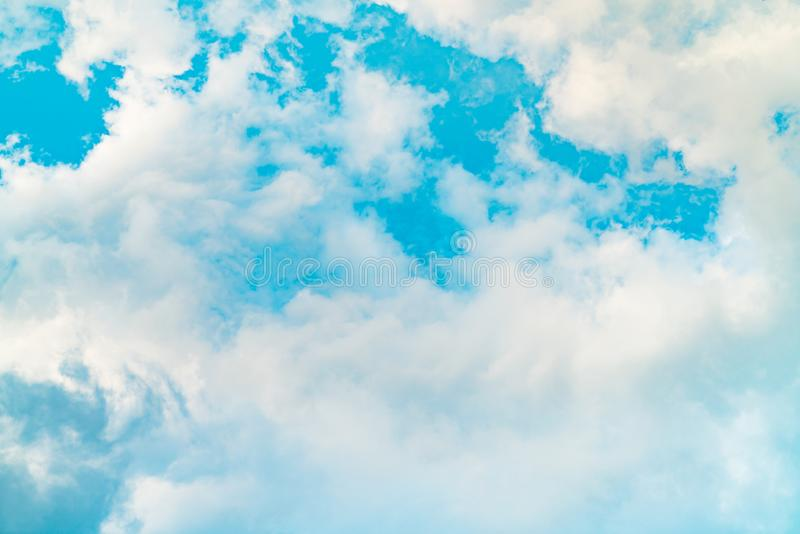 Beautiful blue sky and white cumulus clouds abstract background. Cloudscape background. Blue sky and white clouds on sunny day. royalty free stock photography