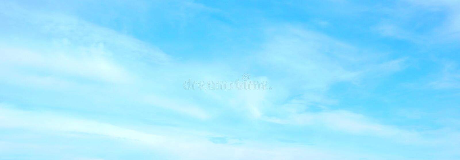 Beautiful blue sky with white fluffy clouds background. Turquoise color blured photography royalty free stock images