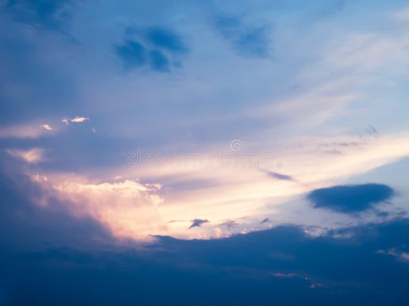 Beautiful blue sunset sky. Cloud like a flying dragon stock image