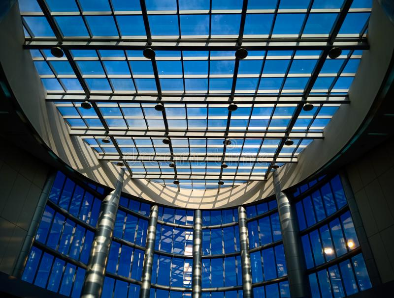 Beautiful blue symmetric architectural design of modern buildings, lines and curves in architecture, modern royalty free stock photography