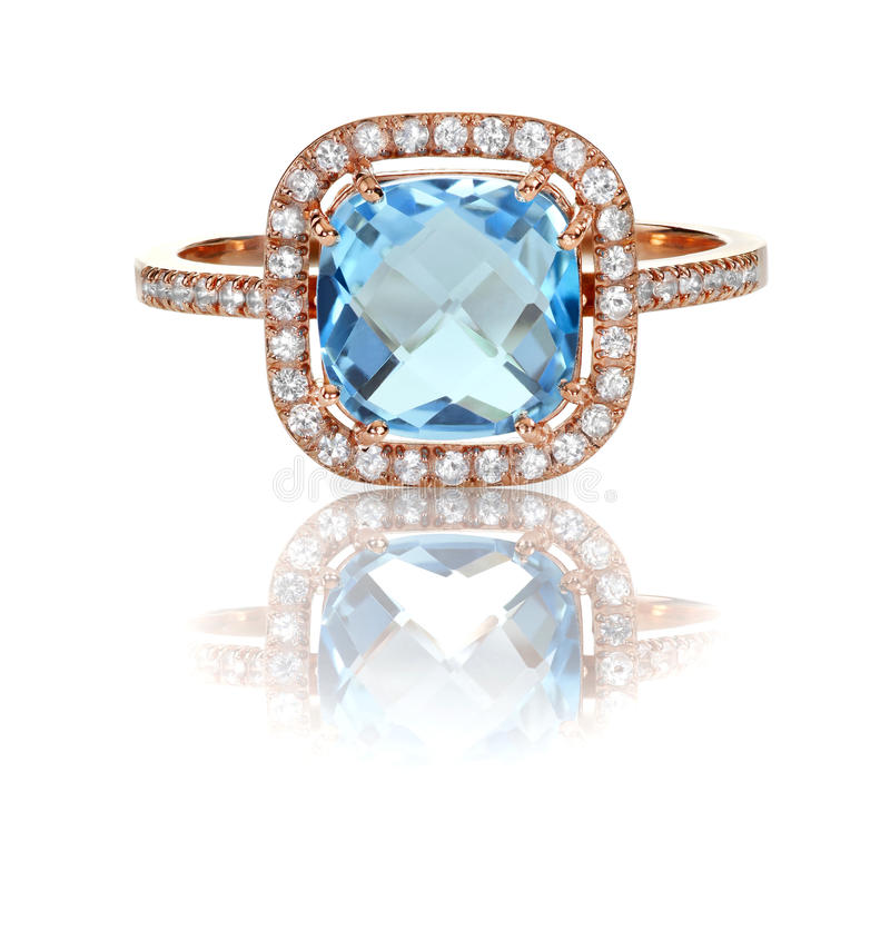 Beautiful Blue Topaz and diamond Rose Gold Halo Ring stock photo
