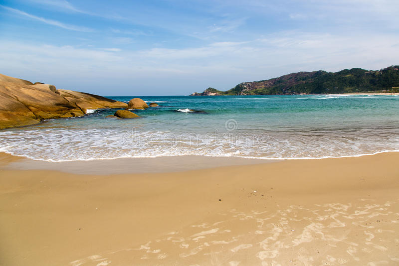 Beautiful blue water and sky in Praia Mole stock image