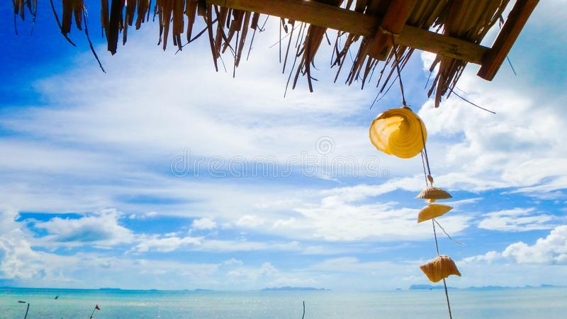 Beautiful blue white sky and sea with palm roof, shell mobile royalty free stock images