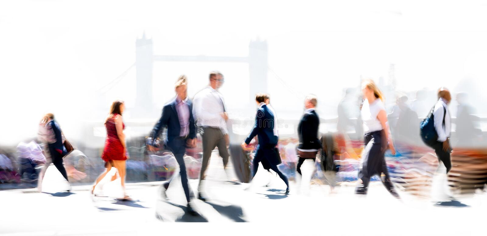 Beautiful blur of business people walking in the City of London. Tower bridge at the background. London, UK. London, UK - 8 May, 2019:  Beautiful blur of stock photo