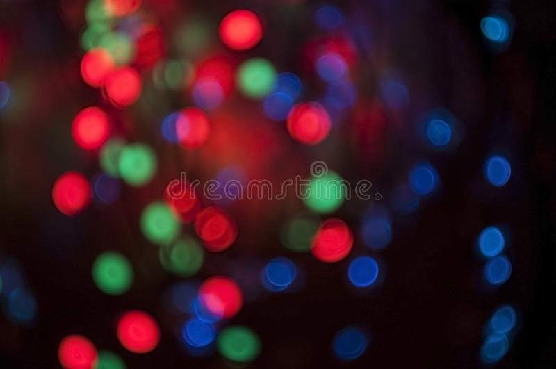 Beautiful blurred bokeh background  with blue and purple and red circles for holiday and Christmas cards stock image