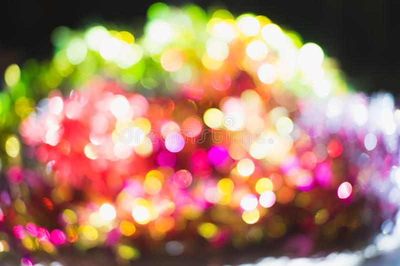 Beautiful blurry light dot colorful in party. The beautiful blurry light dot colorful in party day, pink green shine royalty free stock photo