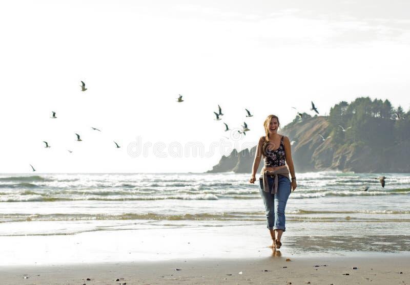 Beautiful bohemian female walking the Pacific Ocean beach in Oregon stock images