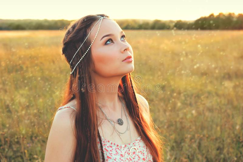 Beautiful boho girl standing in the field royalty free stock photos