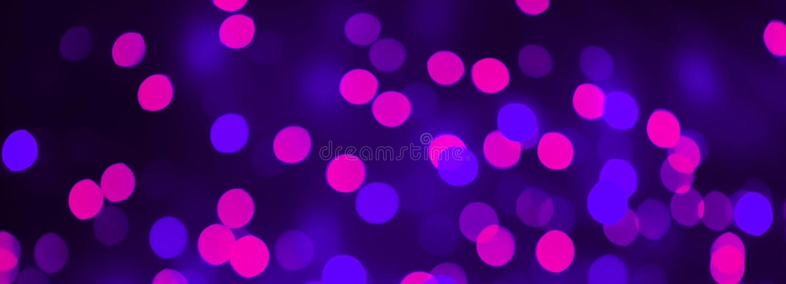 Beautiful Bokeh Purple and blue light Background. Panoramic Decorative Holiday Texture. Backdrop for design. Blurred Festive light stock photo