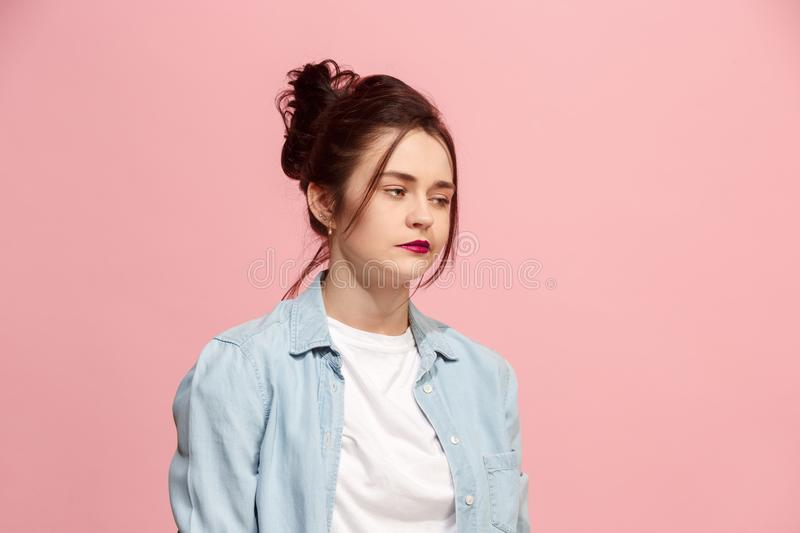 Beautiful bored woman bored isolated on pink background royalty free stock photography
