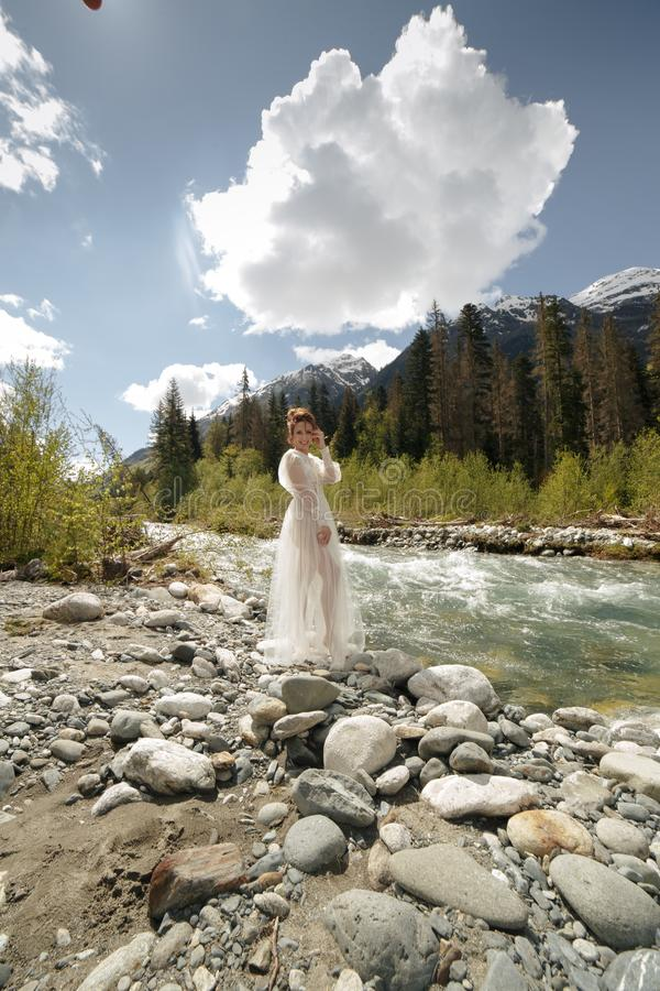 Free Beautiful Boudoir Bride In Bathrobe Dress. Young Girl Fashion Stylish With Bouquet On The Nordic Karelian Nature Royalty Free Stock Photography - 115450437