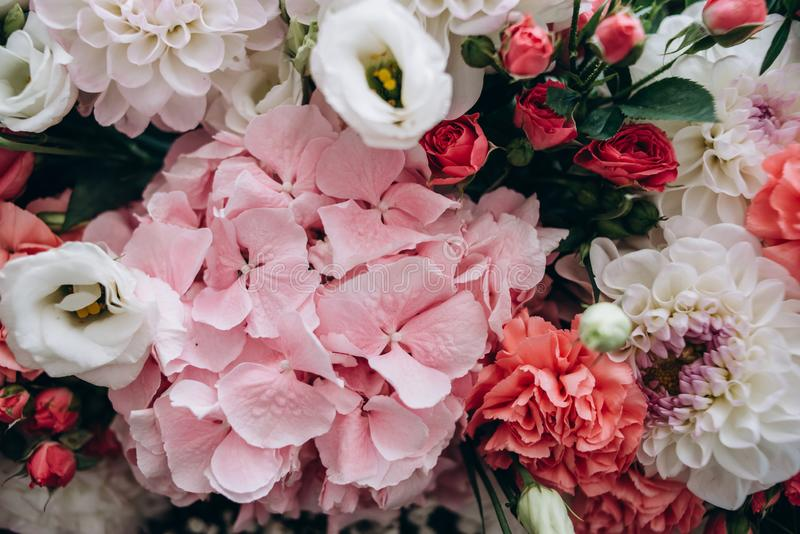 A beautiful bouquet from blue, red, white and pink flowers for decorating festive decor. Natural concept royalty free stock photography