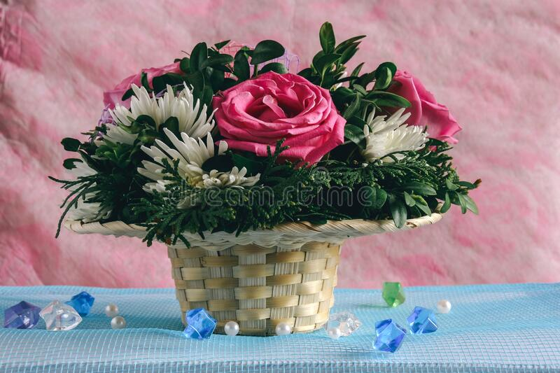 Bouquet of flowers in basket stock photos