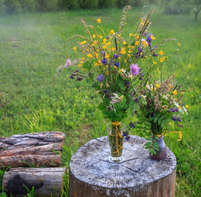 Beautiful bouquet of bright wildflowers on a background of green grass. Handmade beautiful bouquet of bright wildflowers on a background of green grass. Latvia royalty free stock photography