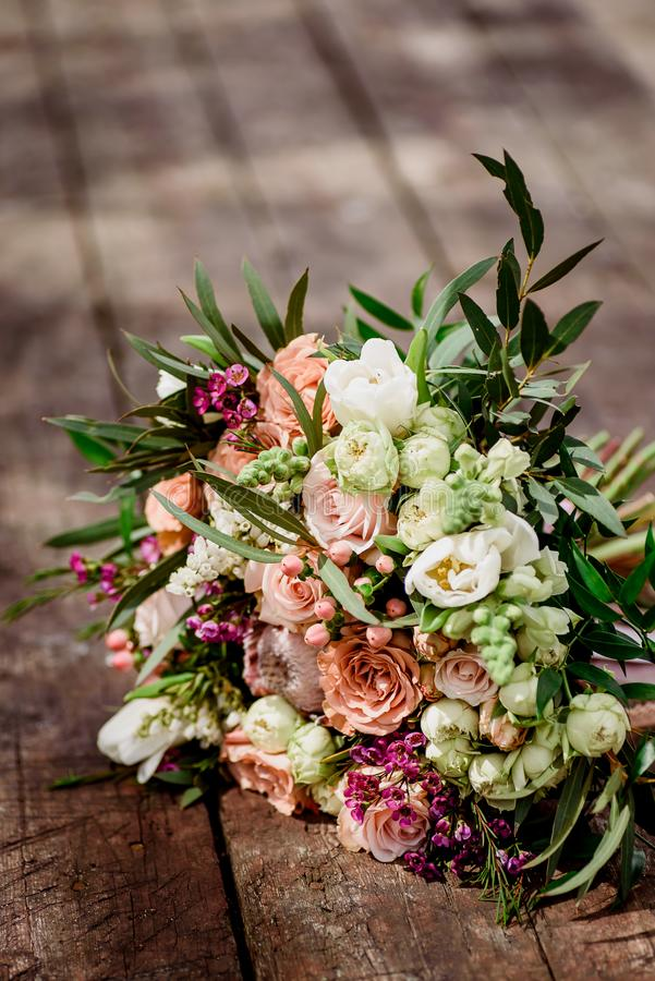 Beautiful bouquet of the bride on a wooden background royalty free stock image