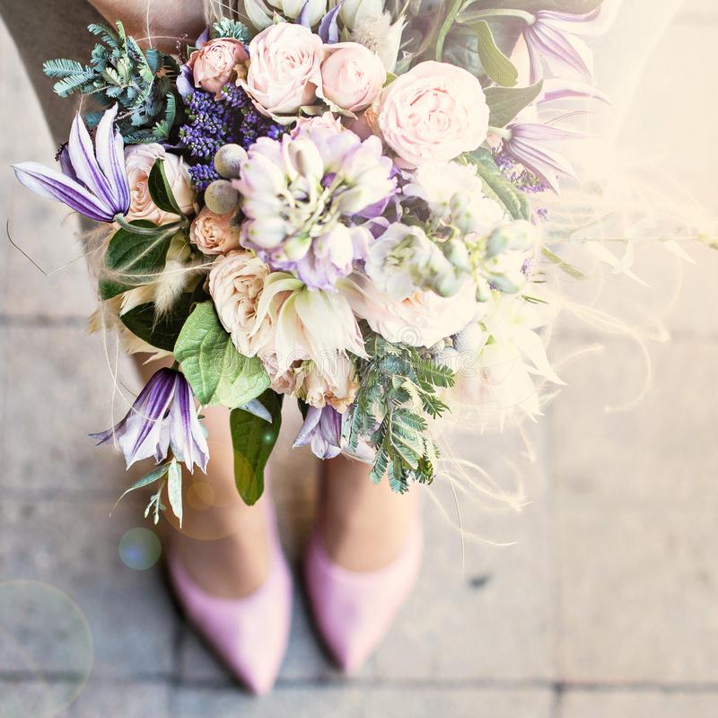 Beautiful bouquet with delicate flowers. Pink-white-purple bouquet. Bridal bouquet in female hands stock image