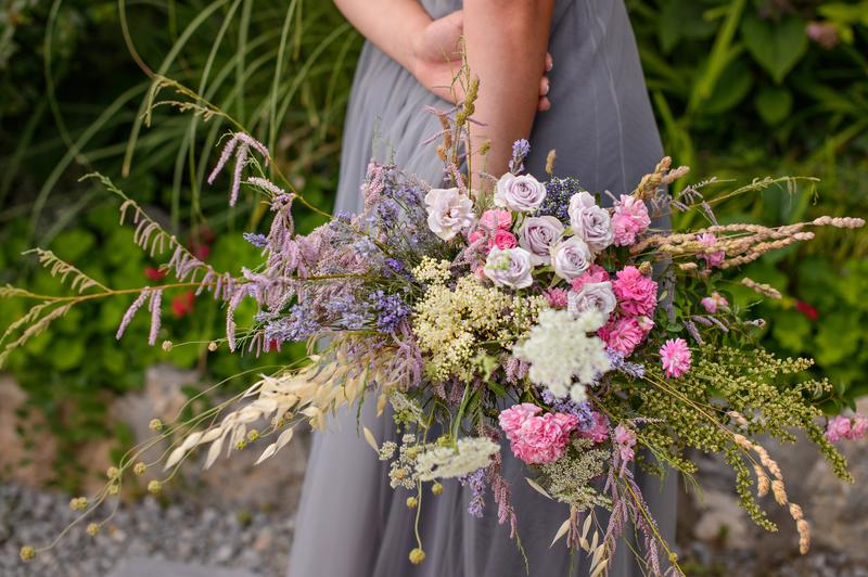 Beautiful bouquet from fine pink roses and different of flowers stock photo