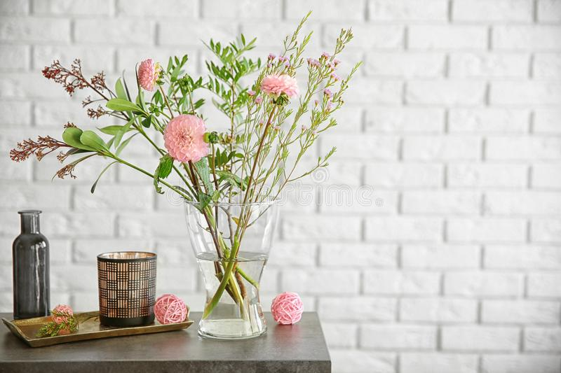 Beautiful bouquet of flowers in glass vase stock photography