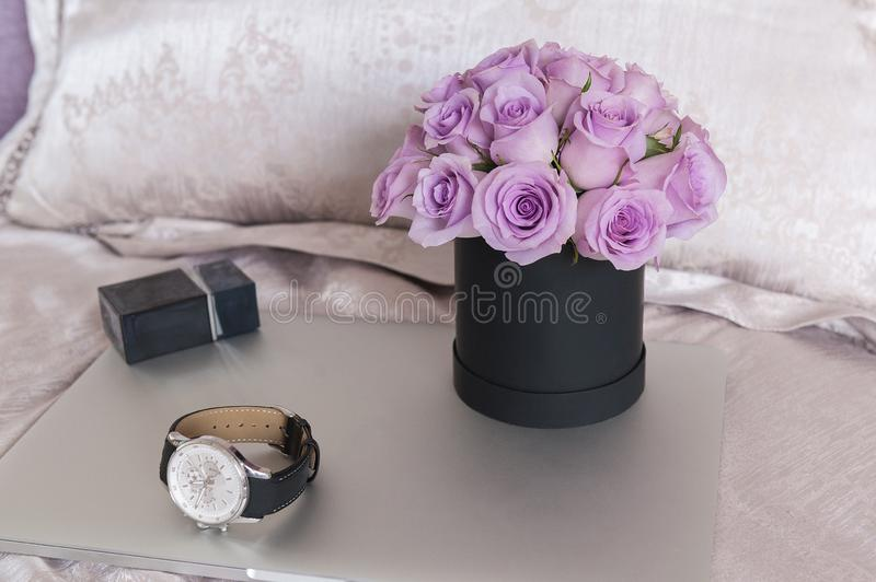 Beautiful Bouquet of flowers in a round hat box on a table stock photos