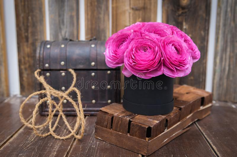 Beautiful Bouquet of flowers in a round hat box on a table stock photography