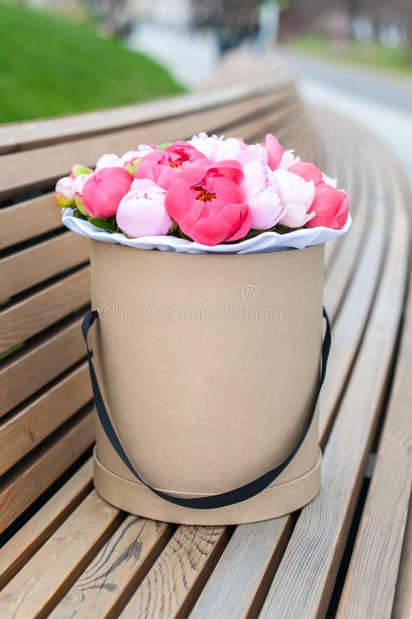 Beautiful Bouquet of flowers in a round hat box on a table royalty free stock images