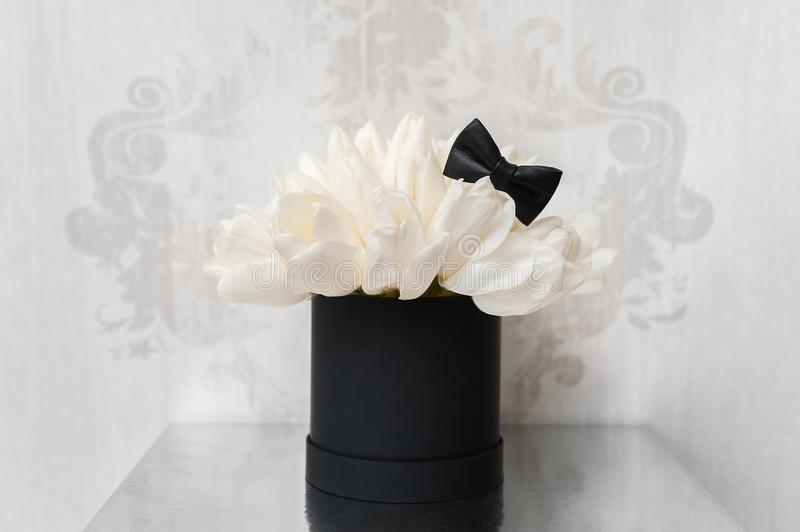 Beautiful Bouquet of flowers in a round hat box on a table royalty free stock image