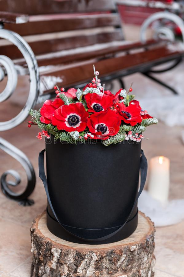 Beautiful Bouquet of flowers in a round hat box on a table stock image