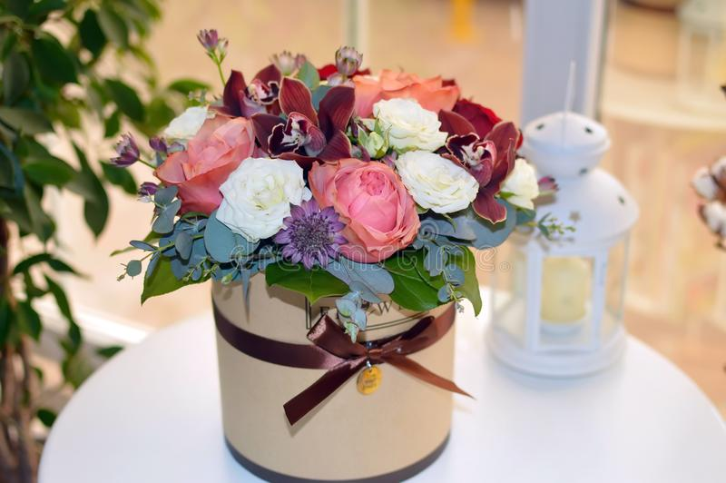 Beautiful bouquet of flowers in a stylish hat box stock photo