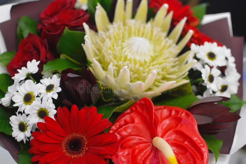 Beautiful bouquet of flowers in a stylish hat box royalty free stock photo