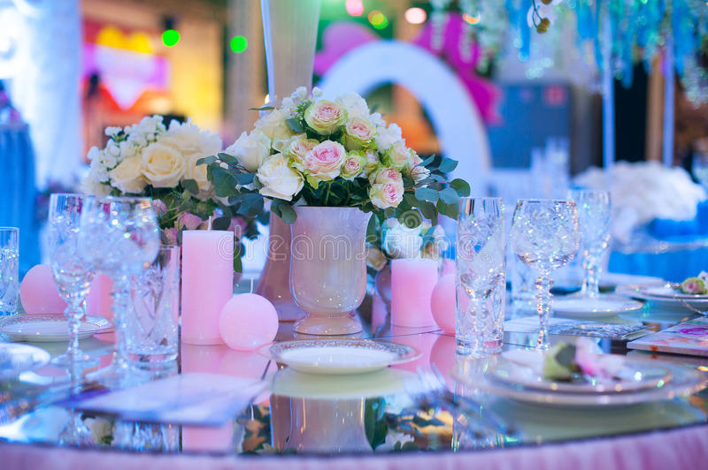 Beautiful bouquet of flowers at the wedding table in a restaurant decor stock photo