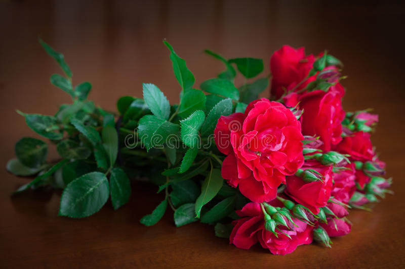 Beautiful bouquet of flowers on wooden table old. stock images
