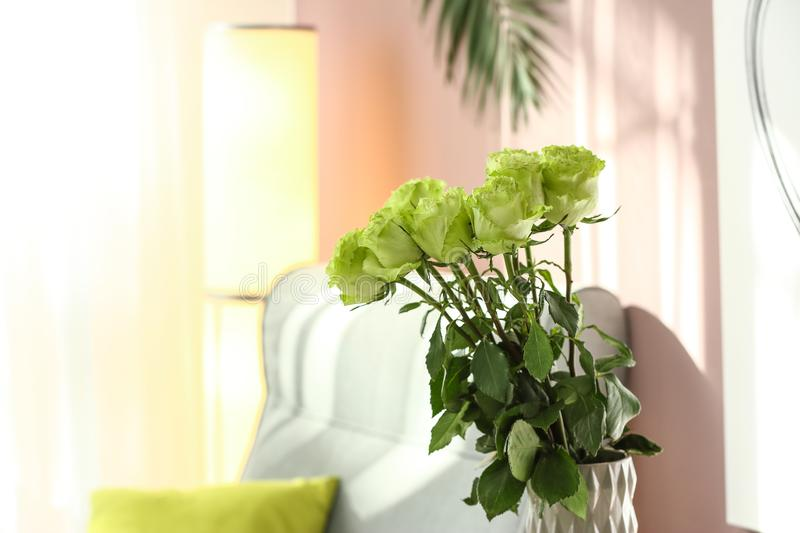 Beautiful bouquet of green roses in vase royalty free stock photos
