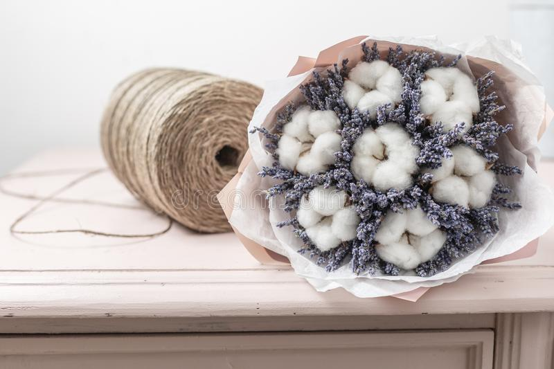 Beautiful bouquet lavender and cotton, on table . dried flowers white and lilac color royalty free stock image