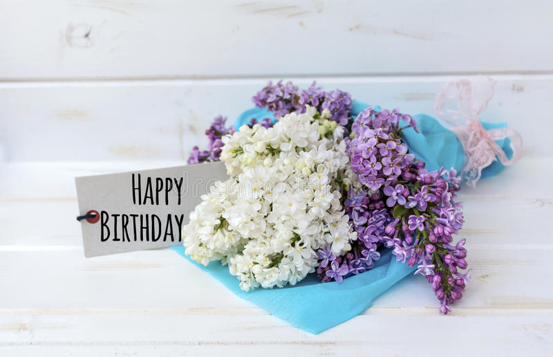 Beautiful bouquet of lilac with happy birthday card stock photo
