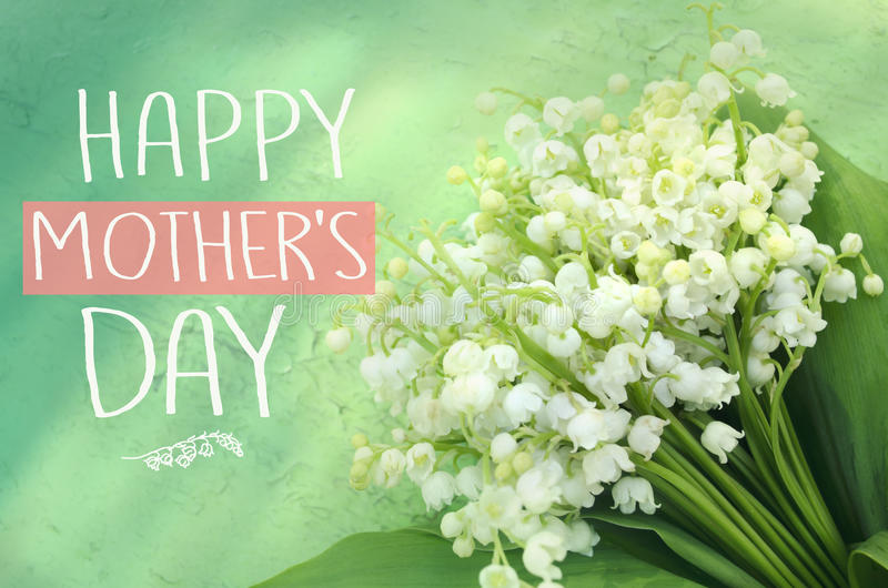 Beautiful bouquet of lilies of the valley. Mother`s day greeting concept royalty free stock images