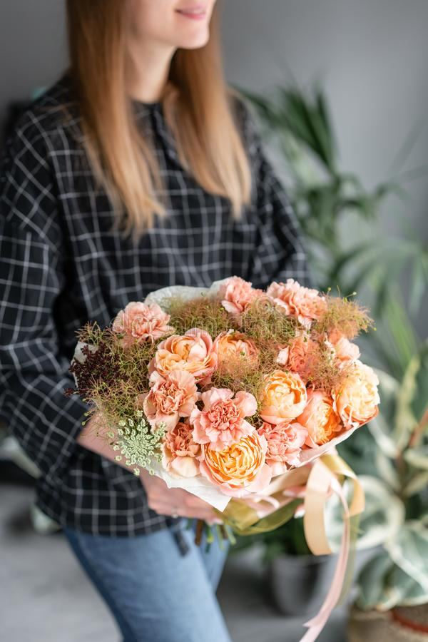 Beautiful bouquet of mixed flowers in woman hand. Floral shop concept . Handsome fresh bouquet. Flowers delivery. royalty free stock photo