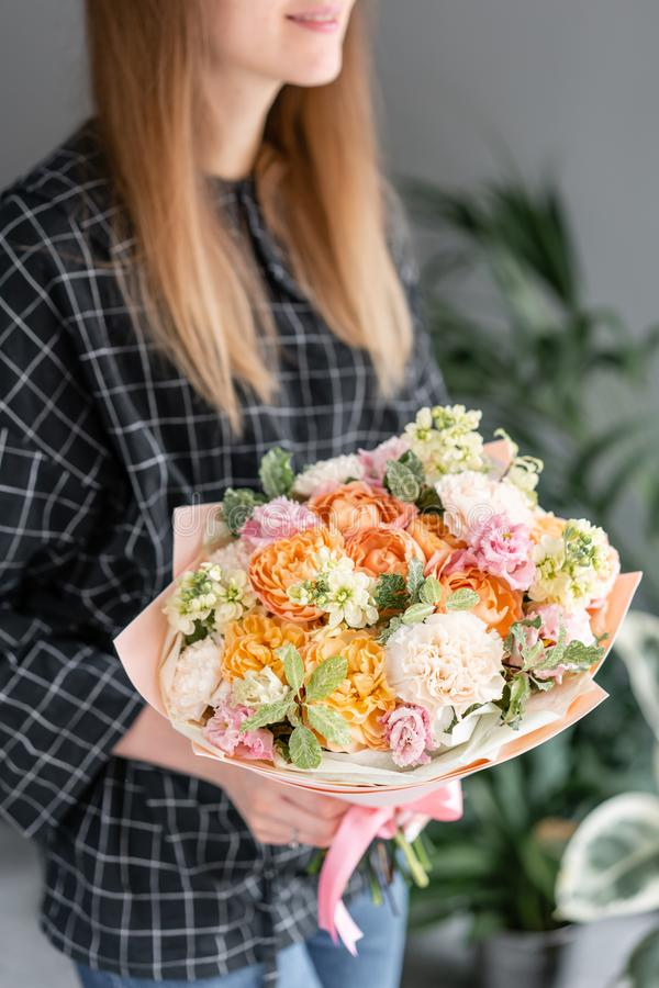 Beautiful bouquet of mixed flowers in woman hand. Floral shop concept . Handsome fresh bouquet. Flowers delivery. stock photos
