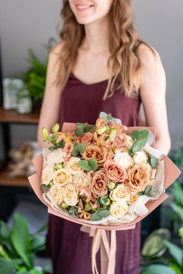 Beautiful bouquet of mixed flowers in woman hand. Floral shop concept . Handsome fresh bouquet. Flowers delivery. stock photography