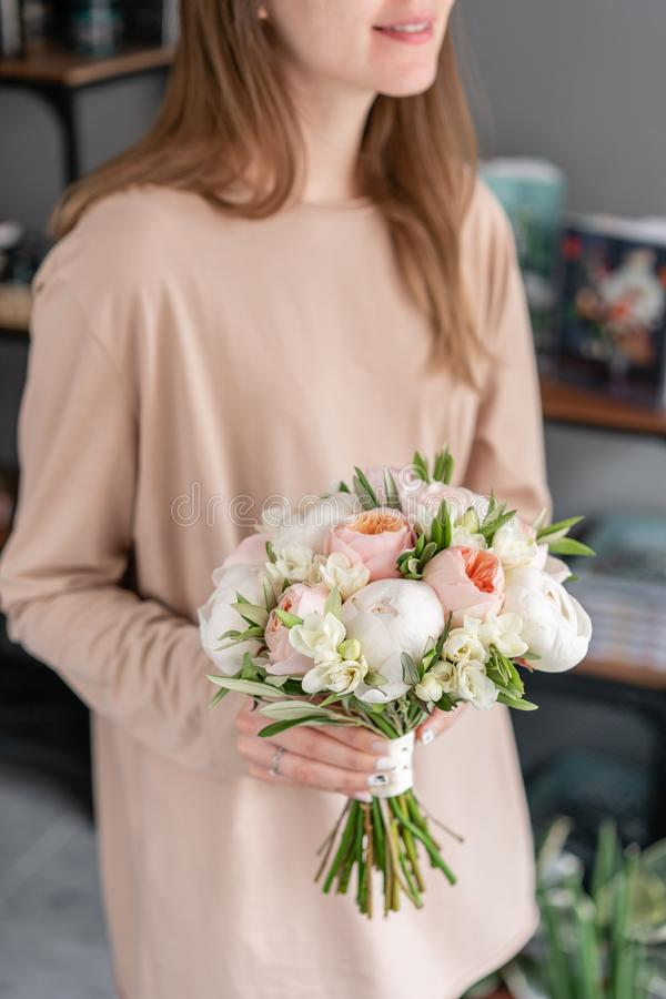 Bridal bouquet with white. Beautiful bouquet of mixed flowers in woman hand. Floral shop concept . Handsome fresh stock image