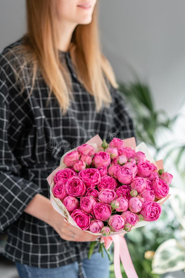 Pink and purple roses . Beautiful bouquet of mixed flowers in woman hand. Floral shop concept . Handsome fresh bouquet royalty free stock image