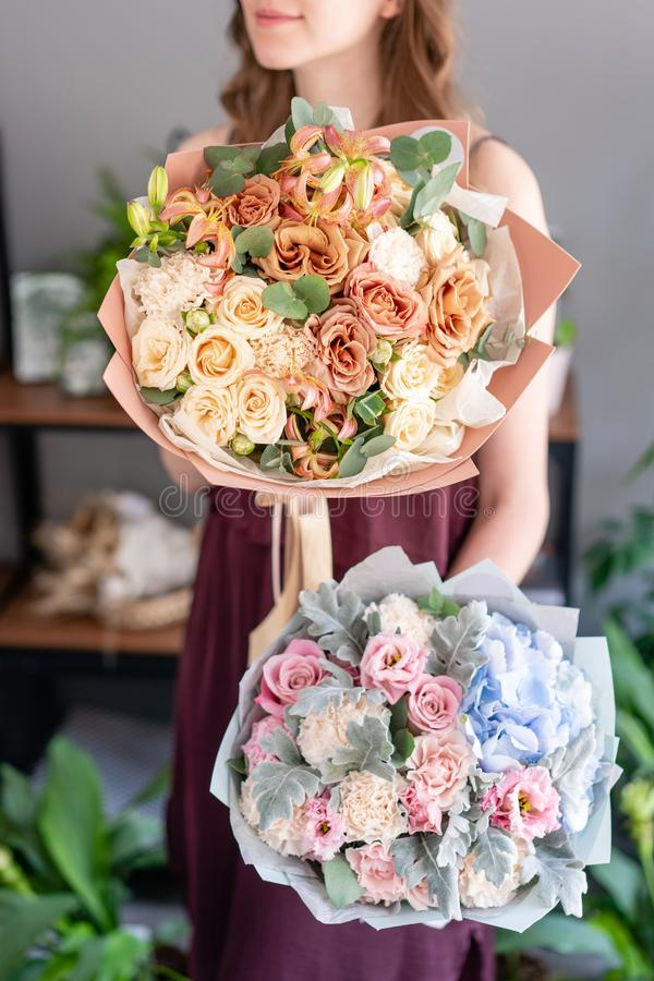 Two beautiful bouquets of mixed flowers in woman hand. Floral shop concept . Handsome fresh bouquet. Flowers delivery. stock photos