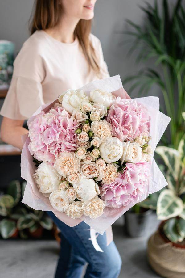 White peonies and pink hydrangea. Beautiful bouquet of mixed flowers in woman hand. Floral shop concept . Handsome fresh stock photography