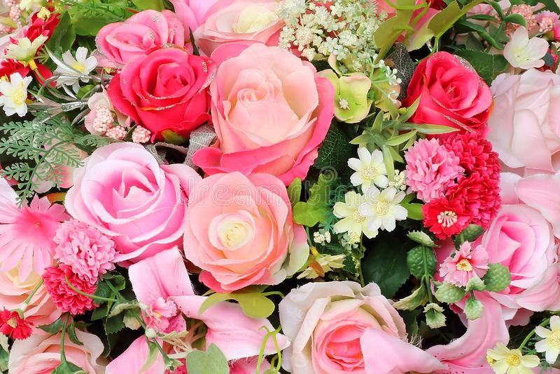 Beautiful bouquet multicolored artificial flowers stock photos