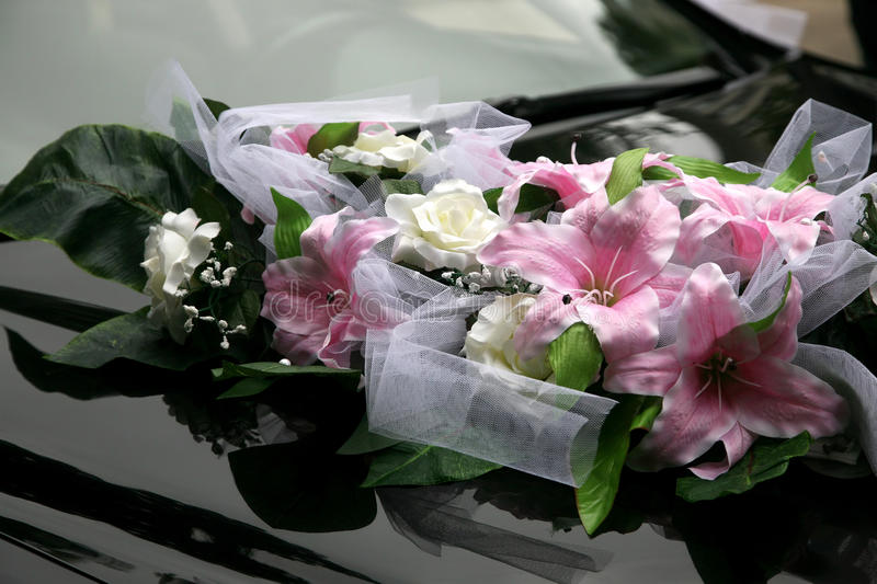 Beautiful bouquet of ornamental flowers on the hood of the car. The beautiful bouquet of ornamental flowers on the hood of the car royalty free stock image