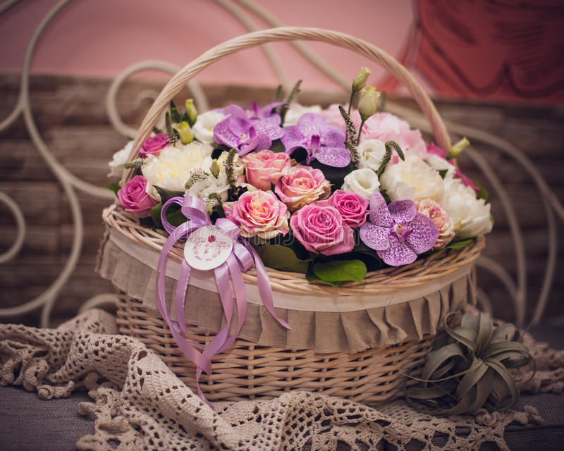 Beautiful bouquet of pink flowers in basket on decorated table stock download beautiful bouquet of pink flowers in basket on decorated table stock photo image of mightylinksfo