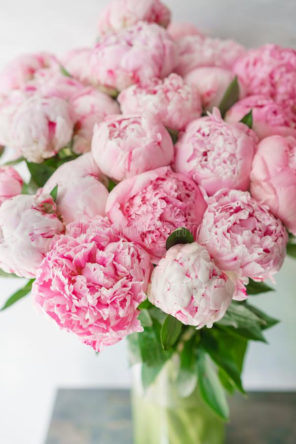 Beautiful bouquet of pink peonies . Floral composition, daylight. Wallpaper. Lovely flowers in glass vase. Lovely flowers in glass vase. Beautiful bouquet of royalty free stock photos