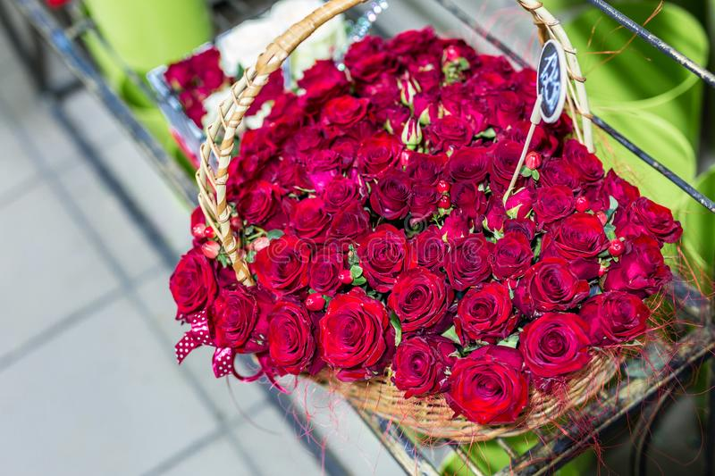 Beautiful bouquet of red roses iin form of Heart . Flowers in wicker basket. Flower market or shop. Florist service concept. Wed royalty free stock images