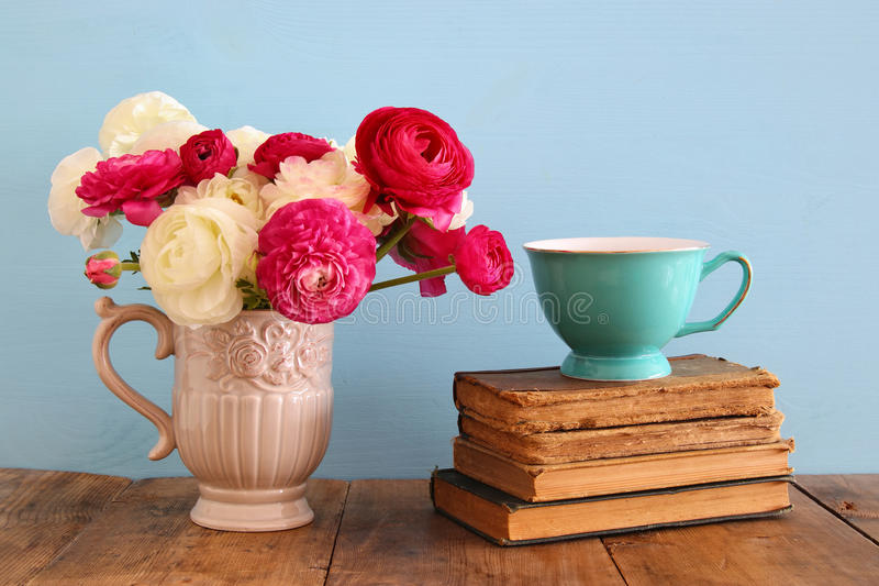 Beautiful Bouquet Of Spring Flowers In The Vase Next To Old Books On