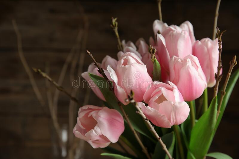 Beautiful bouquet of spring pink tulips on blurred background stock photo